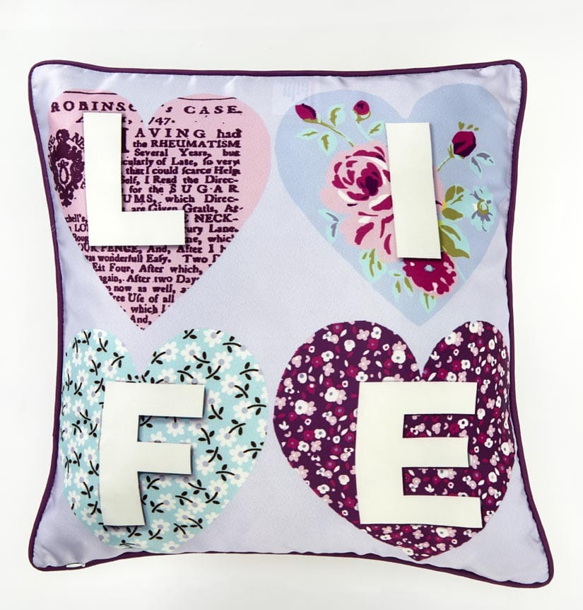 Patchwork Hearts Cushion - Multi - by Arthouse