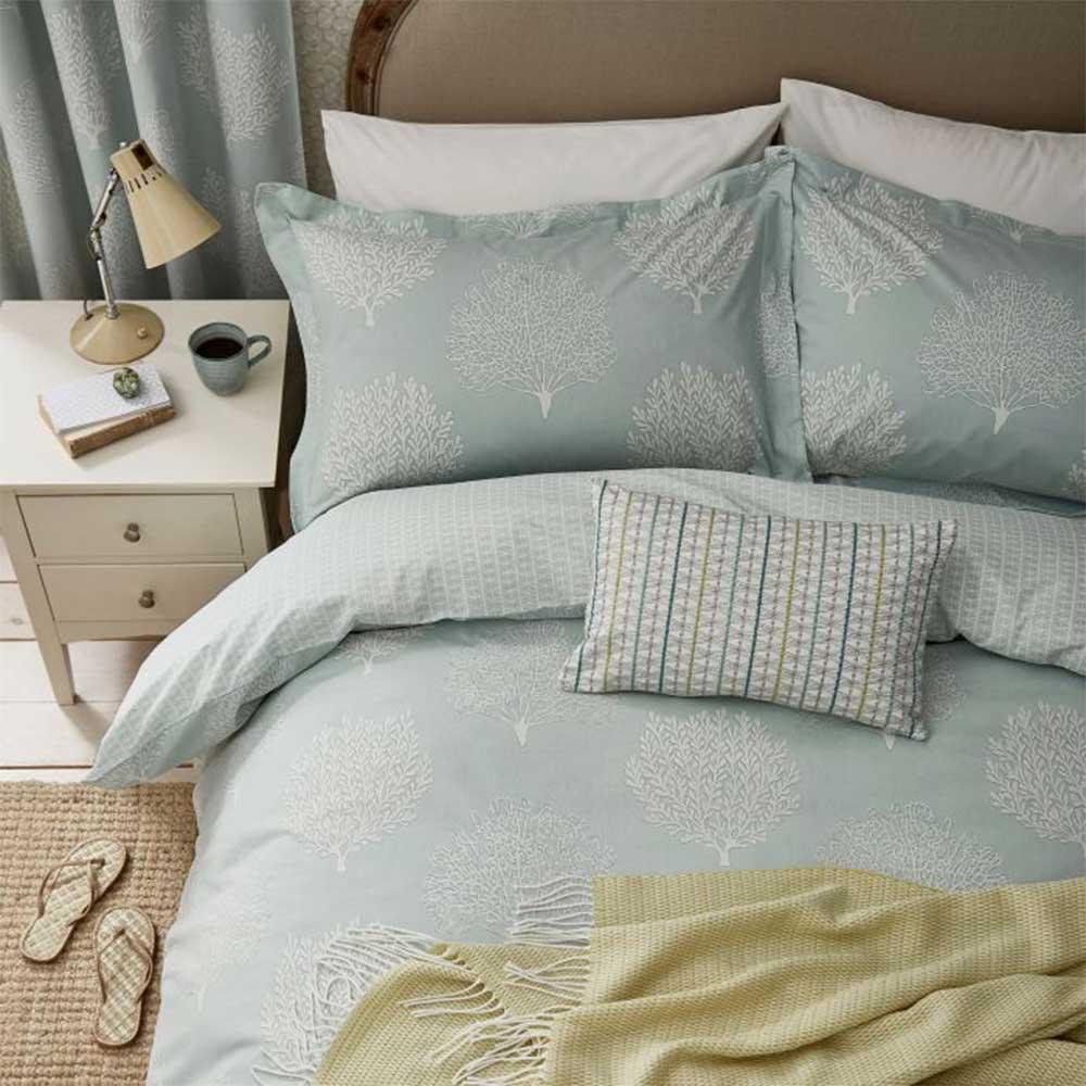 Coraline Cushion - Marine - by Sanderson